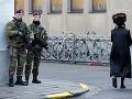 Belgickí vojaci hliadkujú pred