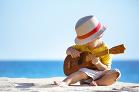 S gitarou na brehu