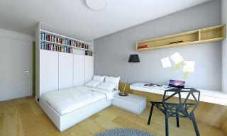 Široká posteľ je umiestnená za šatníkovými skriňami, ktorých zadnú stenu tvorí členený obklad. Ten vich vrchnej časti vystrieda knižnica. Miesto na štúdium pozostáva zpísacieho stola so zásuvkami, konzolovito upevneného na stene, aznízkej skrinky, kto