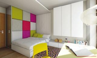 Hravá čalúnená stena je pútavým aj funkčným prvkom. Slúži na opieranie sa pri čítaní apočas návštev sa môže premeniť na gauč.
