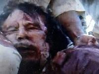 Exkluzívne zábery Kaddáfího mŕtveho tela