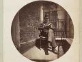 Sediaci muž, čítajúcu knihu, 1888.