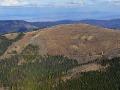 Holoruby vo Volovských vrchoch v Slovenskom rudohorí neďaleko mesta Spišská Nová Ves. Na snímke v pozadí Hornádska kotlina zo Spišským hradom, vpravo na horizonte pohorie Branisko.