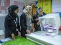 Prvé slobodné voľby od revolúcie v Tunisku: Nízka účasť a víťazstvo islamistov