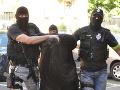 Obvinená Alena Zs. (uprostred) počas príchodu na Špecializovaný trestný súd v Banskej Bystrici
