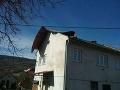 Poškodený dom