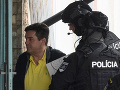 Na snímke Mariana K. predvádzajú na nitriansku pobočku Národnej kriminálnej agentúry