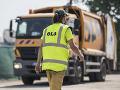 Na snímke pracovník Odvozu a likvidácií odpadu (OLO)