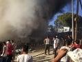FOTO Fatálny požiar v gréckom utečeneckom tábore: Najmenej dvaja migranti sú mŕtvi