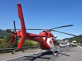 AKTUÁLNE Nešťastie pri Žarnovici: FOTO Kolízia auta s policajnou motorkou, zasahujú leteckí záchranári