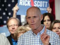 Guvernér Floridy Rick Scott.