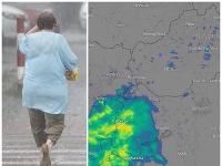 Na snímke žena prechádza cez ulicu počas búrky a silného dažďa v Podunajských Biskupiciach v Bratislave.