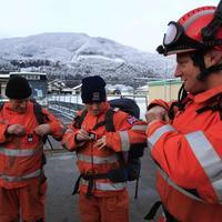 Členovia britského záchranného tímu.