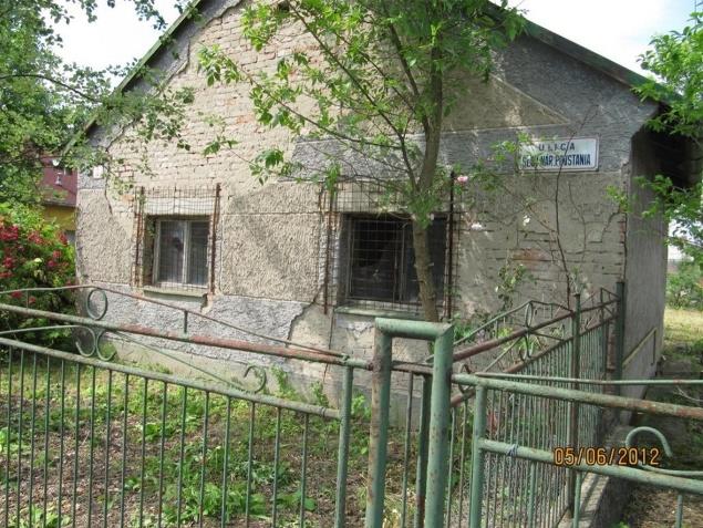 Dom s pozemkom v