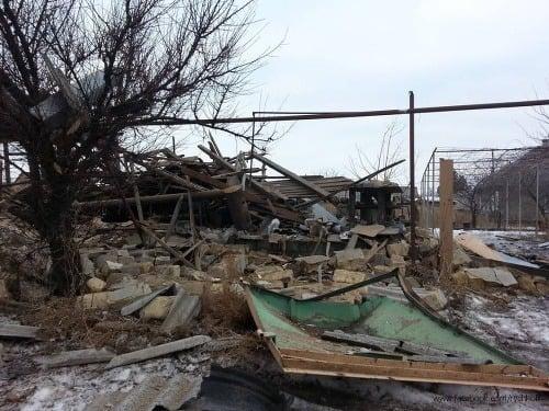 Zničené domy v Luhansku