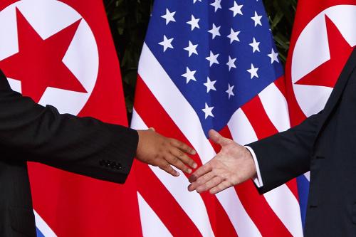 Podanie rúk Kima a
