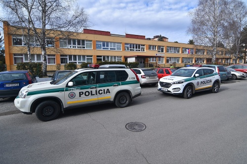 Police vehicles in front of the building