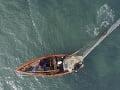 Haitskí rybári nahadzujú sieť