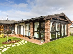 Rodinný dom v Nitre: Interiér vo vidieckom štýle a veľká zimná záhrada