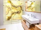 Dominantou kúpeľne je stena