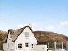 Tehlový domček so slamenou