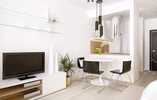 Kuchyňu od obývacej časti s jedálňou oddeľuje pult, ktorého súčasťou je rúra i varná doska.