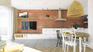 Tehlová stena zdobí najdlhšiu stenu vbyte adodáva celému priestoru tú pravú domácku atmosféru. Nábytok, ktorý sa tiahne pozdĺž nej, je navrhnutý na mieru tak, aby bola kuchynská časť odlíšená od obývacej, no zároveň nenarúšala jednoliatu líniu celej ste